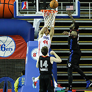 Delaware 87ers Center Ben Strong (44) failed to dunk as Springfield Armor Forward Willie Reed (33) defends in the course of a NBA D-league regular season basketball game between the Delaware 87ers (76ers) and the Springfield Armor (Nets) Saturday, Dec. 28, 2013 at The Bob Carpenter Sports Convocation Center, Newark, DE