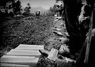 Volcanoes give life but they take life as well.  Mass burial for victims, many unidentified, of Merapi Volcano: Families of victims from the worst eruption of Mt. Merapi in over 100 years, bid farewell to their fallen relatives at a funeral at a public mass grave in a rural area near Sleman, Java, Indonesia.  The death toll from the volcanic eruption has risen to 324 people.