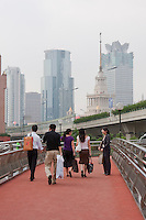 chinese people cross over roads using bridges in Shanghai China