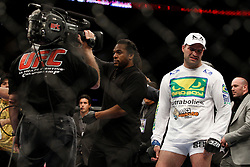 October 24, 2009; Los Angeles, CA; USA; Mauricio Rua(white trunks) reacts with disgust to the decision after his UFC light heavyweight championship bout against Lyoto Machida at UFC 104.   Machida won via controversial unanimous decison.  Mandatory Credit:  Ed Mulholland