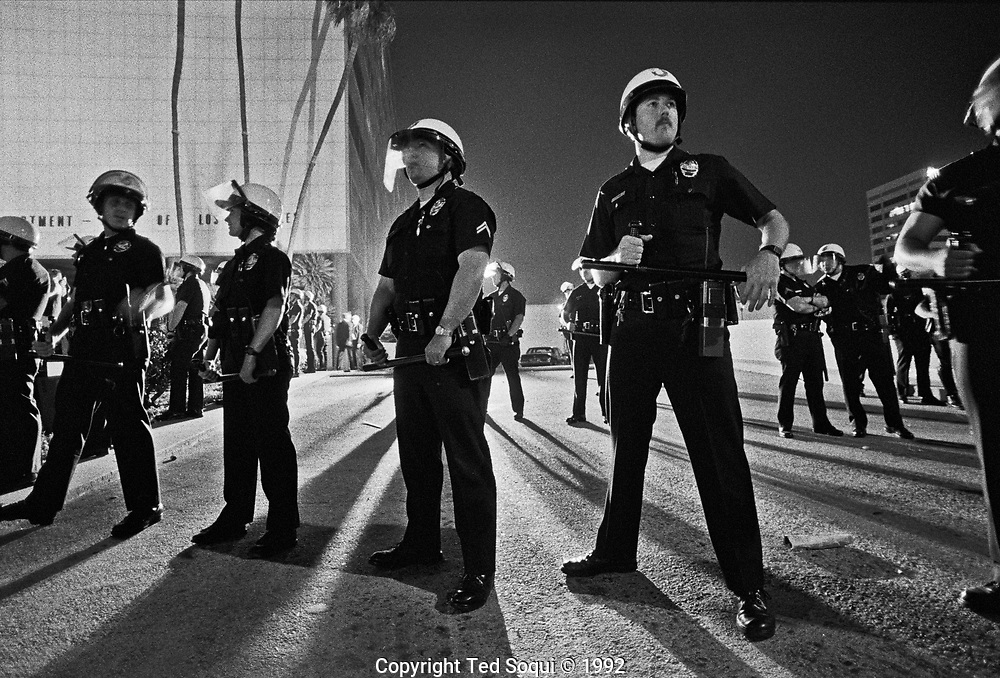 LAPD officers form a line out front of LAPD headquarters, Parker Center, on the first evening of the LA riots. 4/29/1992<br /> <br /> <br /> 25 before and after LA92 photo project.