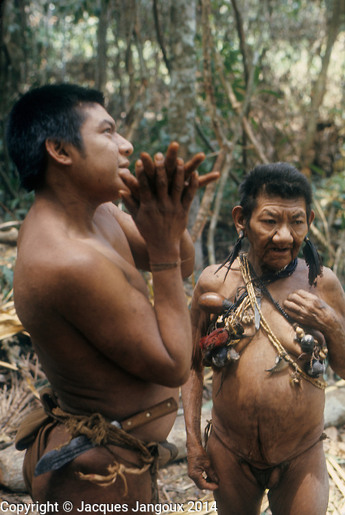 South America, Venezuela, Guiana Highlands. Hoti Indians. Man conversing with old woman shaman.