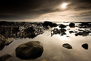 Large rockpools in the reef at Rhosneigr at sunset, West Anglesey, Wales.