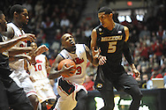 """Mississippi's Derrick Millinghaus (3) scores against Missouri's Jordan Clarkson (5) at the C.M. """"Tad"""" Smith Coliseum in Oxford, Miss. on Saturday, February 8, 2014. Mississippi won 91-88."""
