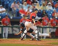 Auburn's Tony Caldwell scores as Ole Miss' Miles Hamblin takes the throw during the Southeastern Conference tournament at Regions Park in Hoover, Ala. on Friday, May 28, 2010.  (AP Photo/Oxford Eagle, Bruce Newman)
