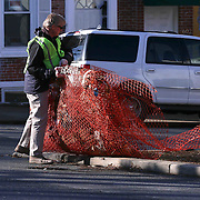Bill Freeborn seen piling up debris for pick up during The Delaware Valley Development Company Inaugural Trash to Cash event Monday, Jan 19, 2015 in Wilmington, Del.