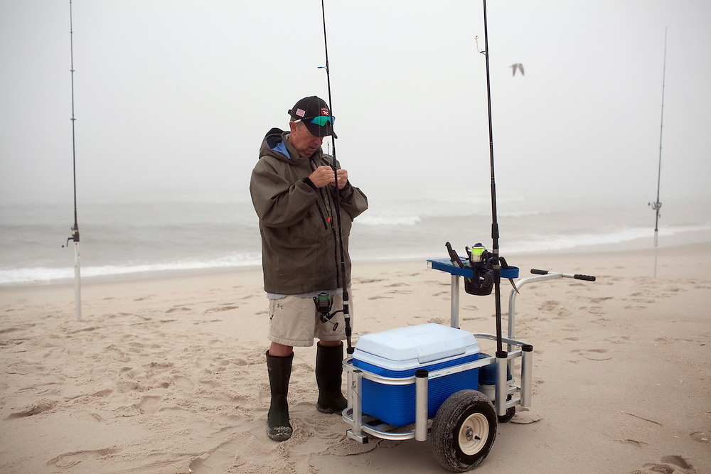 Long Beach Island, NJ - June 30, 2013 :  At dawn, George Rubin, from Willistown, PA, fishes for stripe bass at Beach Haven on Long Beach Island, NJ on June 30, 2013. People are returning to the beaches for the summer after recovery efforts post Hurricane Sandy.