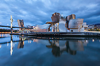 The Guggenheim Museum Bilbao is a museum of modern and contemporary art, designed by Canadian-American architect Frank Gehry, and located in Bilbao, Basque Country, Spain. The museum was inaugurated on 18 October 1997 by former King Juan Carlos I of Spain. Built alongside the Nervion River, which runs through the city of Bilbao to the Cantabrian Sea, it is one of several museums belonging to the Solomon R. Guggenheim Foundation and features permanent and visiting exhibits of works by Spanish and international artists. It is one of the largest museums in Spain.