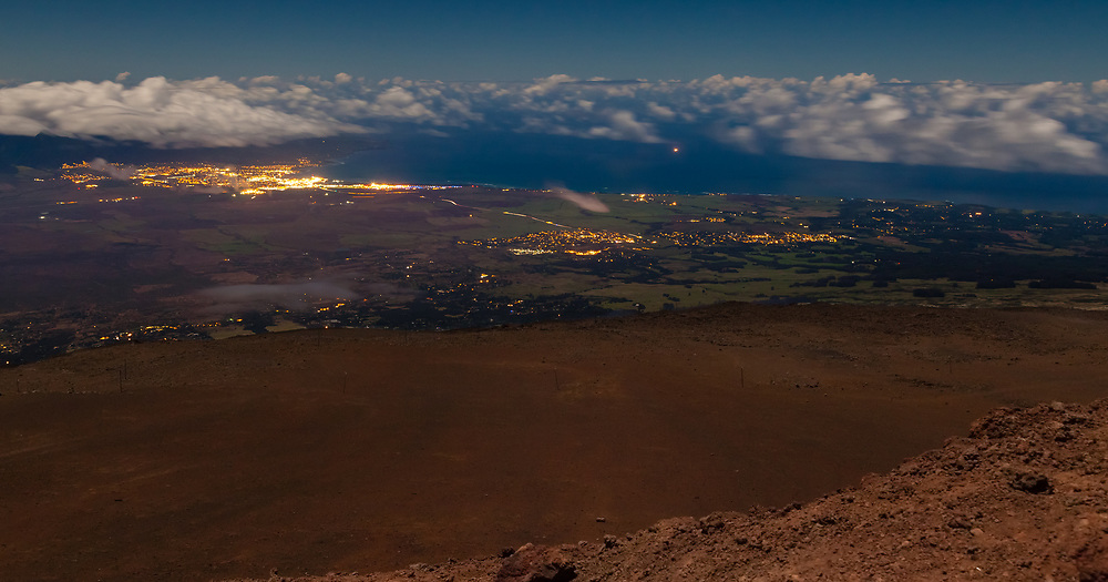 View from atop Haleakala as the full Super Moon lights the central vally of Maui, Hawaii, the Vally Isle.
