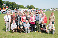 The Angus Show, Brechin, Saturday 8th June, 2013. Group of Estonian farmers with show secretary in the main ring.