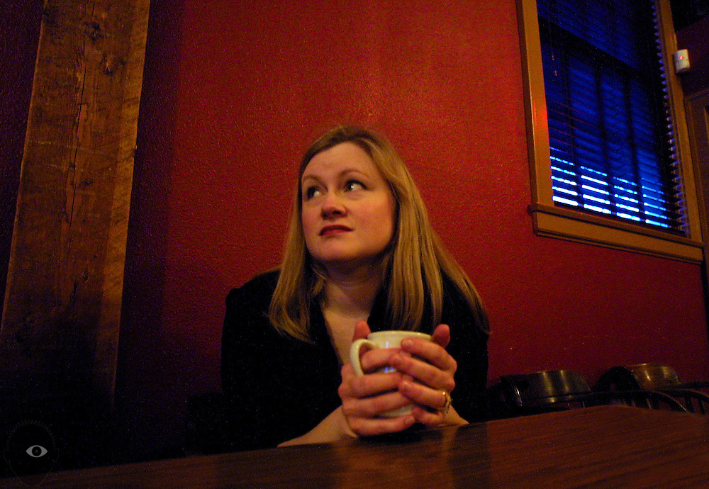 Kathy Walker of the Kathy Walker band warms up with a cup of joe at the Lucky Labrador.