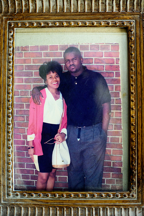 Washington, D.C. - March 29, 2017: An old photo of Charles &quot;Chuckie&quot; Craig with one of his girlfriends at his mother Claudette Craig's Washington DC home Wednesday March 29, 2017. Ms. Craig lost two of her five children to gun violence. Charles &quot;Chuckie&quot; Craig, Kevin Durant's coach and mentor, was gunned down April 30th, 2005 in Laurel, Md., at the age of 35. Durant wears #35 as tribute to Craig.<br /> <br /> Her eldest, Ryan, a marine, was killed during a family visit to Georgia by a rival of his cousin when he was 20-years-old. <br /> <br /> NBA Superstar Kevin Durant's jersey number &quot;35&quot; is a tribute to his rec. league coach and mentor Charles &quot;Chuckie&quot; Craig, who was gunned down in at a night club in Laurel, Md., in 2005 when he was 35 years old. <br /> <br /> CREDIT: Matt Roth for The New York Times<br /> Assignment ID: 30204524A