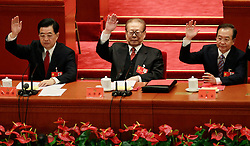 epa03469902 Chinese President Hu Jintao (L), former president Jiang Zemin (C) and Premier Wen Jiabao (R) raise their right hand to show approval of a work report during the closing ceremony of the 18th CPC (Communist Party Congress) in Beijing, China, 14 November 2012. The CPC is expected to introduce the new leadership lineup and the Standing Committee of the Politburo on 15 November, a day after the closing.  EPA/HOW HWEE YOUNG