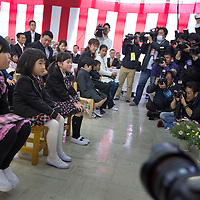 New entrants to the school, are photographed by the Japanese media as they join the School and kindergarten entrance ceremony, at Kawauchi community centre, in Kawauchi, Japan on Friday 6th April 2012. Restrictions on residents living in, and visiting their homes and business in Kawauchi, have just been relaxed and approximately 533 people have moved back out of an original town population of 2,856. The residents initially left due to fears over high levels of nuclear radiation contamination from the explosions at the Fukushima Daiichi nuclear plant which is approximately 25-30km away from the town. The nuclear plant exploded in the aftermath of the earthquake and tsunami which hit the Tohoku coastline on 11th March 2011.