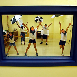 """Gloucester: Children rehearse for a dance number shortly before the opening ceremonies of the new Child Development Programs building on Emerson Avenue Thursday. The children sang and dance to """"Singing in the Rain."""" Left to right are Macy Tocco, Leidy Marrero, Hailey Howell, Josh Davis, and Vanessa Chaisson. (Photo by Mike Dean/Gloucester Daily Times). Thursday, June 12, 2003 (NOTE: THIS IS A DIGITAL CAMERA IMAGE)..**************************************.Filter: Min (QMPro: Red Radius:3/Blue Radius:9/Desp.).USM: Normal (Amt:200/Radius:0.3/Thresh:2).File Size: 7.67MB.Original file name: DSC_7934.JPG"""