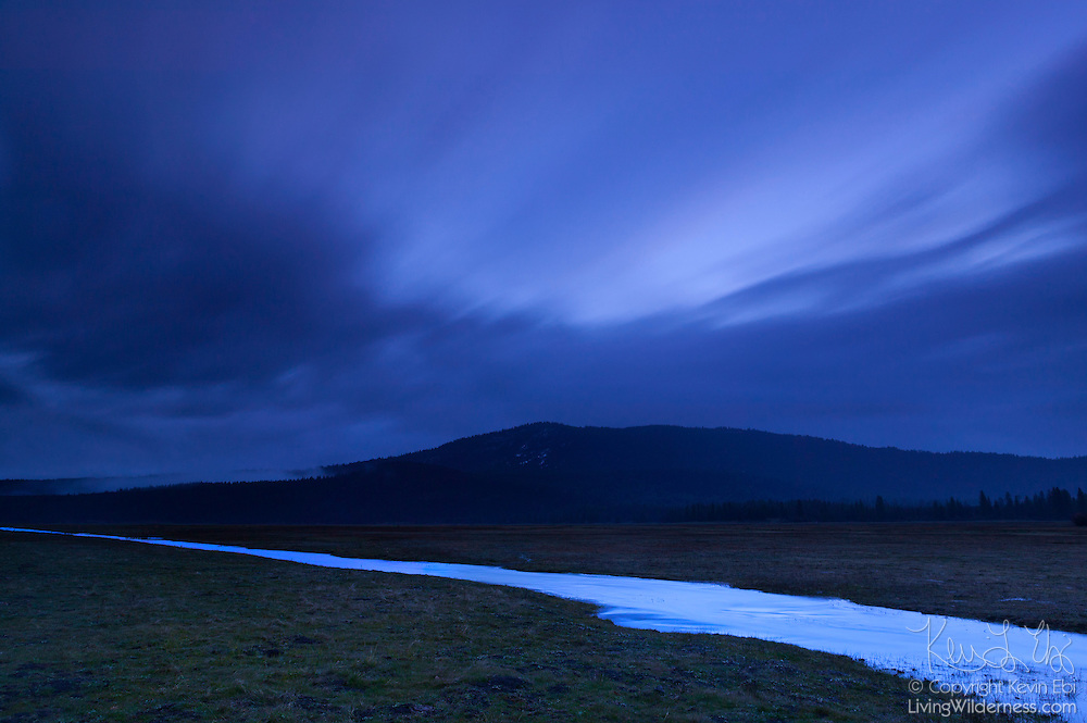A long exposure captures the clouds streaking over Soldier Mountain and Cayton Creek in Shasta County in northern California.