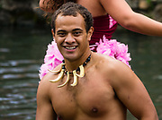 """Samoan dancers in the Canoe Pageant, """"Rainbows of Paradise."""" The Polynesian Cultural Center (PCC) is a major theme park and living museum, in Laie on the northeast coast (Windward Side) of the island of Oahu, Hawaii, USA. The PCC first opened in 1963 as a way for students at the adjacent Church College of Hawaii (now Brigham Young University Hawaii) to earn money for their education and as a means to preserve and portray the cultures of the people of Polynesia. Performers demonstrate Polynesian arts and crafts within simulated tropical villages, covering Hawaii, Aotearoa (New Zealand), Fiji, Samoa, Tahiti, Tonga and the Marquesas Islands. The Rapa Nui (Easter Island) exhibit features seven hand-carved moai (stone statues). The PCC is run by the Church of Jesus Christ of Latter-day Saints (LDS Church). For this photo's licensing options, please inquire."""