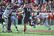 Ole Miss defensive back Charles Sawyer (3) blocks a punt by Arkansas punter Dylan Breeding (14) at War Memorial Stadium in Little Rock, Ark. on Saturday, October 27, 2012. Ole Miss won 30-27...