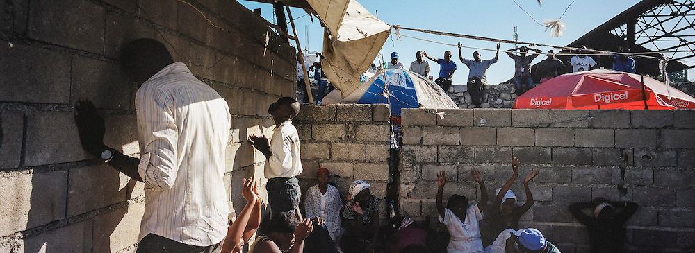 Worshipers at L'Eglise Evangelique Piscine de Bethesda, the church of televangelist Marcorel Zidor, on Saturday, December 20, 2014 in Port-au-Prince, Haiti. Pastor Zidor attracts a large audience with his emotional services and miracle medical cures of dubious theraputic value.