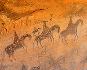 0100-1001B ~ Copyright: George H. H. Huey ~ Navajo Indian pictograph of Spanish horsemen in Canyon del Muerto -- depicting Spanish invasion of the early 1800's. Canyon de Chelly National Monument, Arizona.