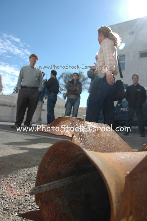 Israel, Sderot, People near the remains of a Qassam rocket launched by Hamas from Gaza January 21st 2007