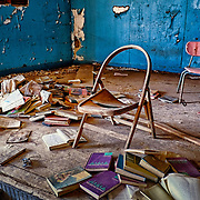 A decaying and abandoned rural Oklahoma school awaits demolishing along old route 66 near Chandler, Ok.