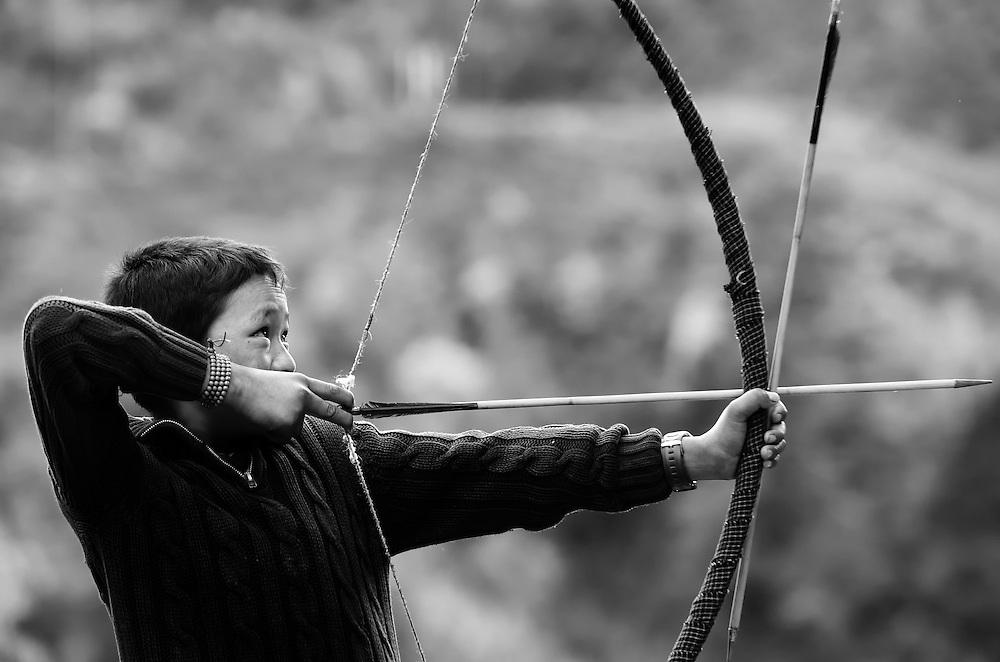 A boy in eastern Bhutan hones his archery skills.