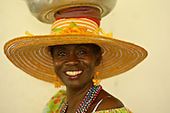Palenquera: Palenqueras are dark-skinned women who, dressed in multicolored dresses and swaying their hips, walk while they balance bowls of fresh fruit on their heads. They symbolize the struggles of the black cimarrones - slaves who courageously escaped from their owners in search of a better future.