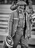 Swiss Formula One driver Clay Regazzoni was a favorite of many fans, stemming from his years with Ferrari, as Niki Lauda's teammate, his fearless personality and his never-ending love of pure racing. Here in 1977, at the United States Grand Prix, he drove for Mo Nunn's Ensign, where he wouls finish fifth. He would move to Williams in 1979 and revive his career in the FW07, winning the British Grand Prix.<br /> <br /> He had his greatest success with Ferrari before and during the Lauda years. His first Grand Prix victory came in 1970, when he would finish 3rd in that years World Driver's Championship. He returned to Ferrari from 1974 finishing 2nd in the Driver's Championship that year and capturing three more Grand Prix victories through 1976.<br /> <br /> Regazzoni returned to Ensign in 1980 and suffered an enormous crash at the United Staes Grand Prix West in Long Beach tag left him paralyzed from the waist down. After recovery his strength, he continued competing in specially-adapted vehicles at the Paris-Dakar rally.