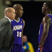 Iowa Energy Head Coach Nate Bjorkgren seen talking to Iowa Energy Guard Moses Ehambe (17) during a timeout in the second of a NBA D-league regular season basketball game between the Delaware 87ers (76ers) and the Iowa Energy Tuesday, Jan 14, 2014 at The Bob Carpenter Sports Convocation Center, Newark, DE