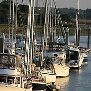 Various types of boats docked at a Jekyll Island boat dock.