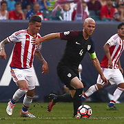 United States Midfielder MICHAEL BRADLEY (4) dribbles down the field as Paraguay Attacker ANTONIO SANABRIA (9) defends in the first half of a Copa America Centenario Group A match between the United States and Paraguay Saturday, June. 11, 2016 at Lincoln Financial Field in Philadelphia, PA.