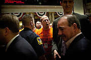 Wisconsin Democratic Rep. Nick Milroy, center, and other Democrats yell  at Republican representatives as they leave the Assembly chambers after manuevering to quickly pass a bill to eliminate collective bargaining at the State Capitol in Madison, Wisconsin, February 25, 2011.