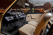 Image of a tan sports car interior and the Seattle skyline in Seattle, Washington, Pacific Northwest, Porsche 1967 911S, property released