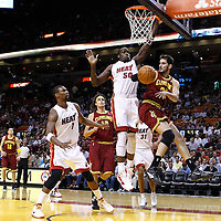 24 January 2012: Cleveland Cavaliers small forward Omri Cassi (36) passes the ball past Miami Heat center Joel Anthony (50) during the Miami Heat 92-85 victory over the Cleveland Cavaliers at the AmericanAirlines Arena, Miami, Florida, USA.