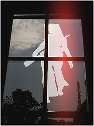 Figure of a Vietnamese soldier imprinted on a window, Hanoi, Vietnam, Southeast Asia