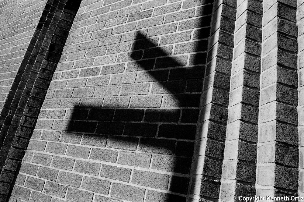 Street Sign shadow on a brick wall.