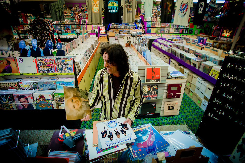 ORLANDO, FL -- Owner Fred Ehman stocks records among thousands of records, CDs, and memorabilia fill every inch of the widely known Rock -n- Roll Heaven in Orlando, Florida.  (PHOTO / Chip Litherland)