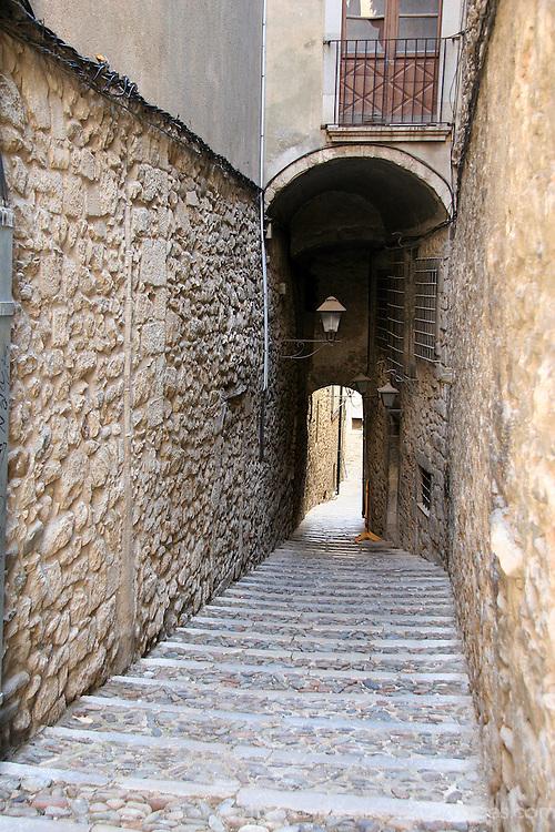 Europe, Spain, Girona. Steps of walkway and tunnel in Girona.