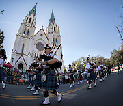 Members of the Dublin Fire Brigade Pipe Band perform while marching past The Cathedral of St. John The Baptist during the St. Patrick's Day parade, Tuesday, March 17, 2015, in Savannah, Ga.The St. Patrick's Day tradition in Savannah dates back to the first parade held on March 17, 1824. (AP Photo/Stephen B. Morton)