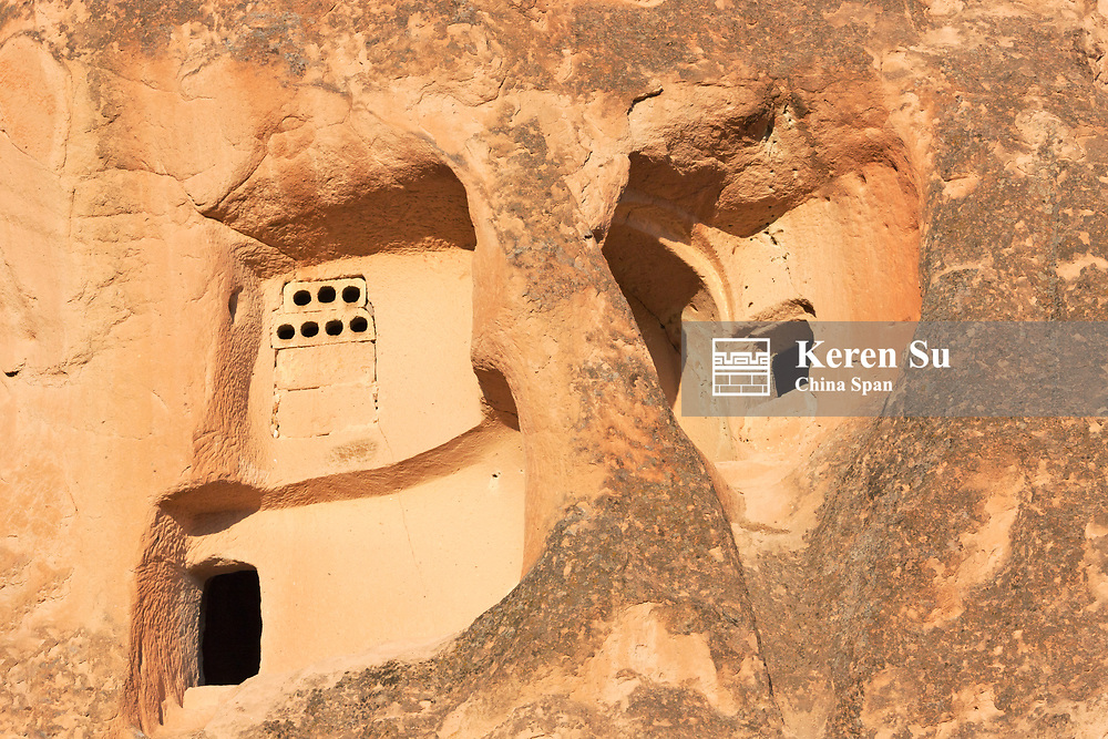 Houses carved into the rock formations in the valley, Goreme National Park, Cappadocia, Turkey
