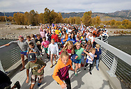 The first children storm thle new pathways bridge over the Snake River on Sunday morning as hundreds gather on the new span moments after the ribbon cutting.