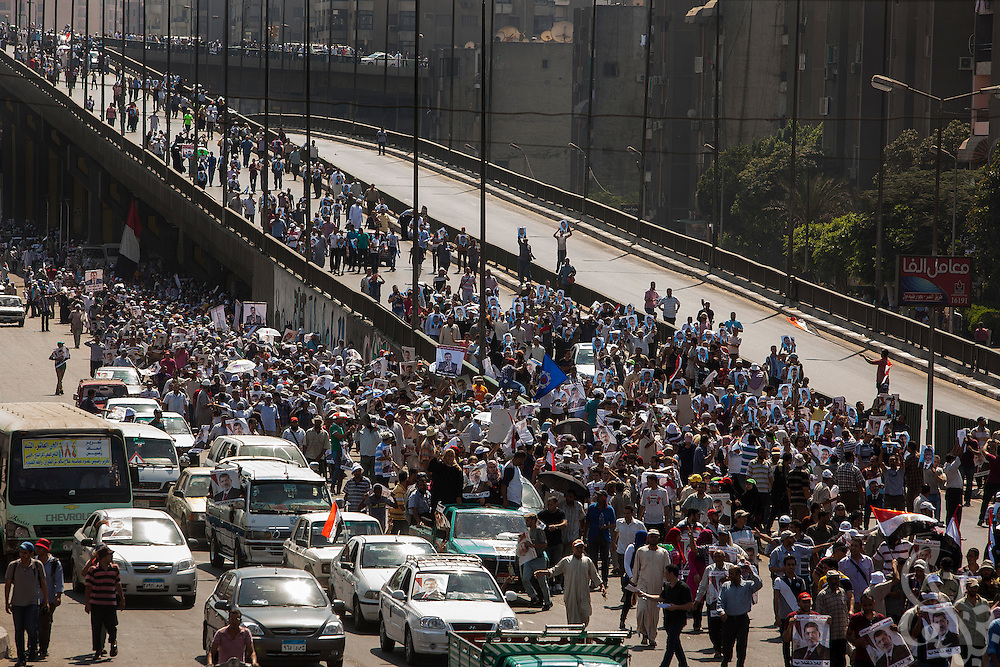 Supporters of deposed Egyptian president Mohamed Morsi stream into the area near a large scale demonstration and sit-in around the Rabaah al-Adawia mosque and square in the Nasr City district of Cairo Friday July 26, 2013.  The supporters are demanding the reinstatement of the deposed President and are opposed to the Egyptian military, which they say has undertaken an undemocratic coup.