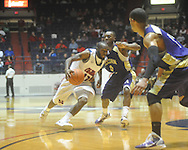 "Ole Miss guard Chris Warren (12)  dribbles against Alcorn State's Kendrick McDonald (0) at the C.M. ""Tad"" Smith Coliseum in Oxford, Miss. on Thursday, December 29, 2010. Ole Miss won 100-62. (AP Photo/Oxford Eagle, Bruce Newman)"