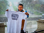 01 MAY 2017 - ST. PAUL, MN: An immigrants' rights protester holds up his May Day tee shirt in a May Day snowstorm at the Minnesota State Capitol. There was an unusual May snowstorm in St Paul after the march. About 300 people, representing immigrants' and workers' rights organizations, marched through the Minnesota State Capitol during a demonstration to mark May Day, International Workers' Day.      PHOTO BY JACK KURTZ