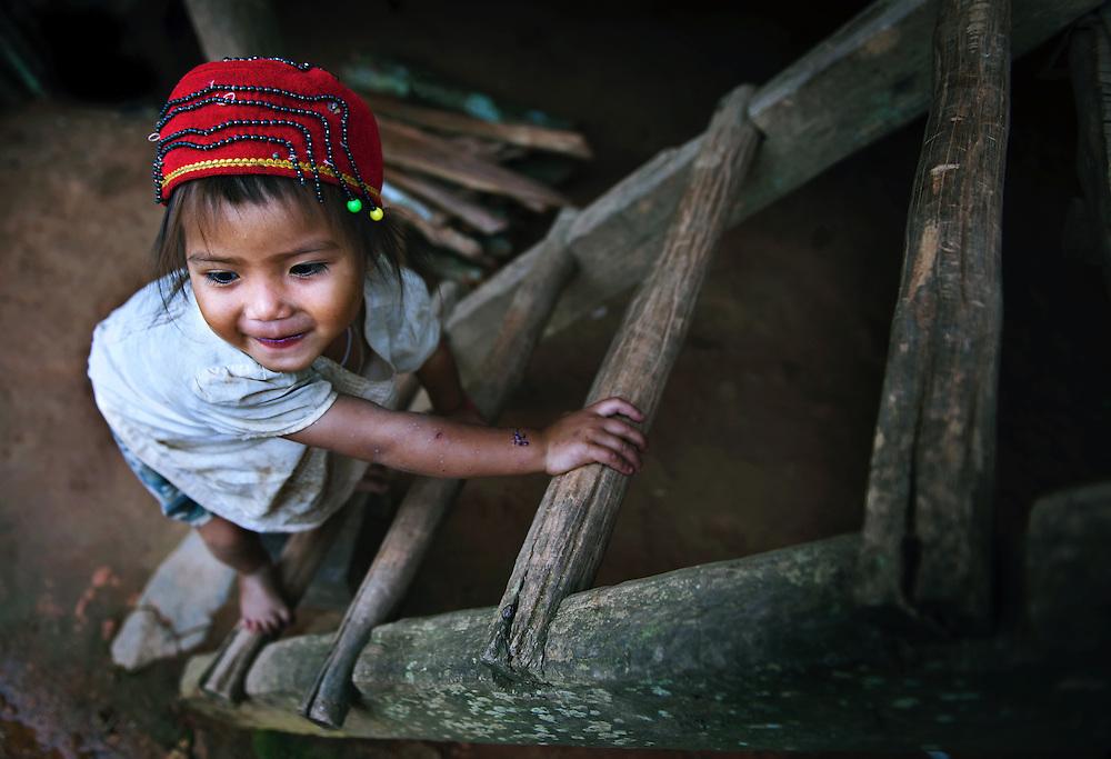 A Khamu girl at home near Luang Prabang, Laos.