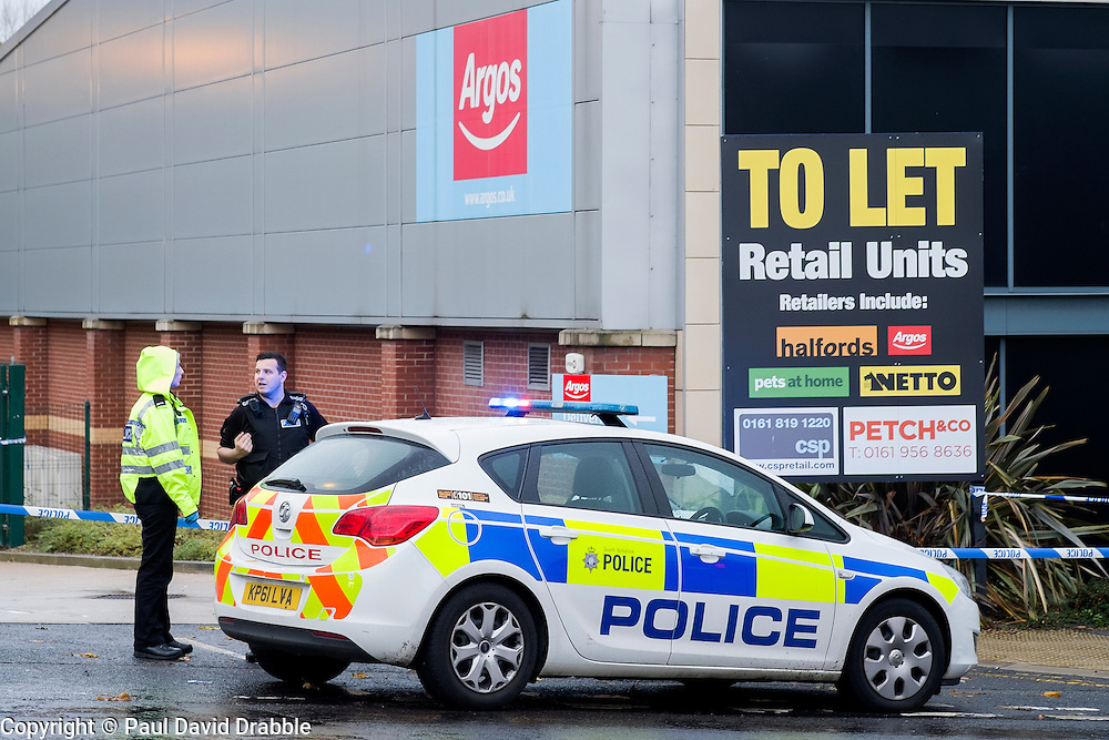 Police Block the Argos goods entrance from the Halifax Rd crime scene, stretching from Kilner way to Southey Green Rd. Locals information say the crime was a stabbing.<br /> <br /> 29 October 2015<br />  Image &copy; Paul David Drabble <br />  www.pauldaviddrabble.co.uk