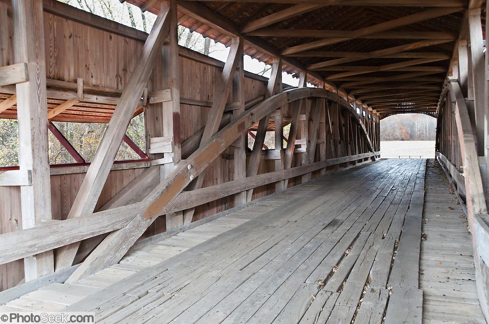 A Burr Arch Truss supports Neet Covered Bridge (126 feet long), built in 1904 by J.J. Daniels over Little Raccoon Creek, on Bridgeton Road, Parke County, Indiana, USA.