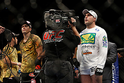 October 24, 2009; Los Angeles, CA; USA; Lyoto Machida (black trunks) and Mauricio Rua(white trunks) wait for the decision after their UFC light heavyweight championship bout at UFC 104.   Machida won via controversial unanimous decison .  Mandatory Credit:  Ed Mulholland