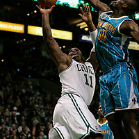 Boston, MA - Boston Celtics forward Glenn Davis has his fall away shot blocked by New Orleans Hornets forward Emeka Okafor in the first quarter at TD Garden on New Years Eve, December 31, 2010.   Photo by Matthew Healey